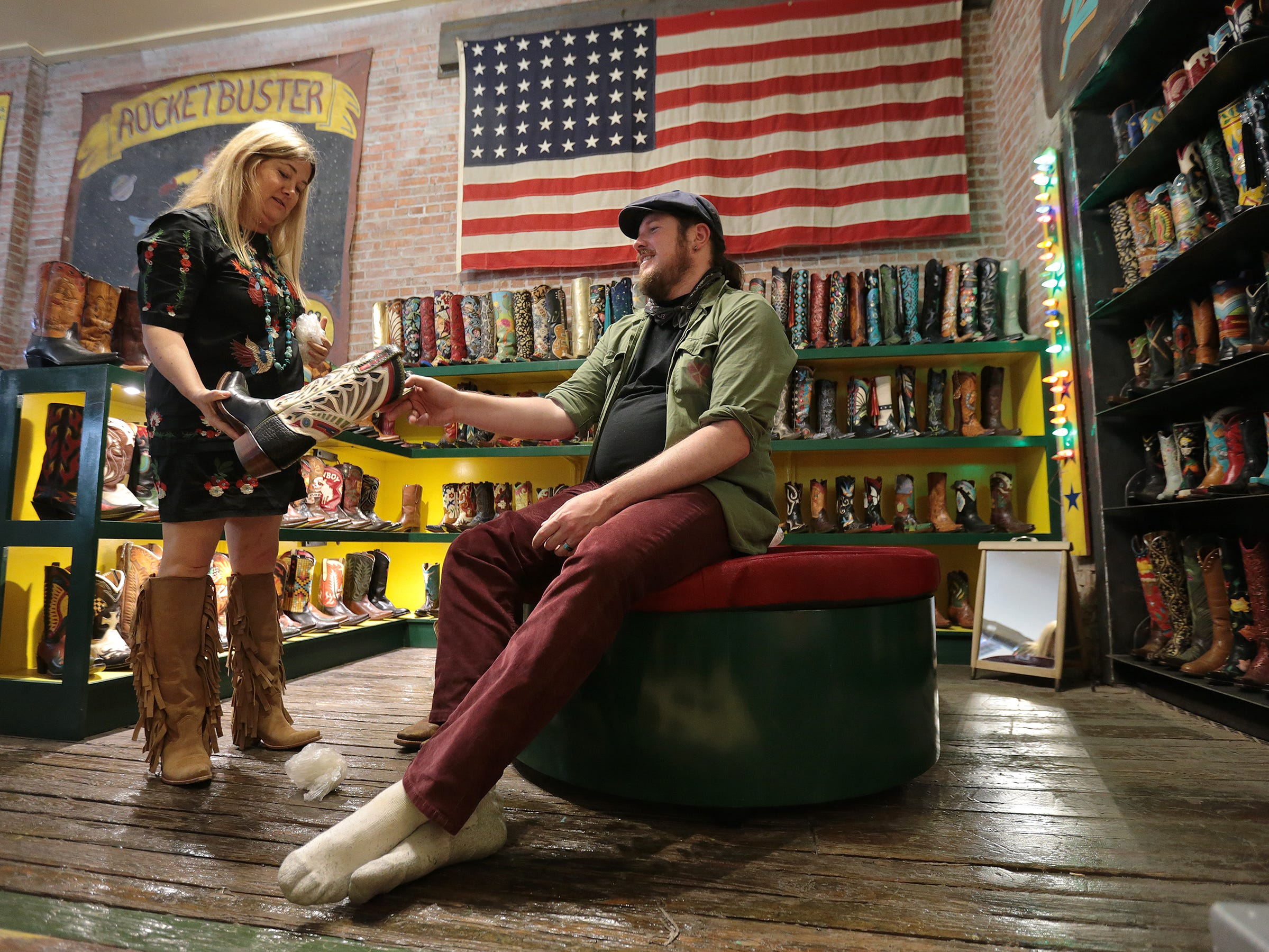 "Rocketbuster Boots owner Nevena Christi fits ""Blaze"" star Ben Dickey with a pair of custom boots Tuesday as he and Ethan Hawke visited the popular boot shop in Downtown El Paso."
