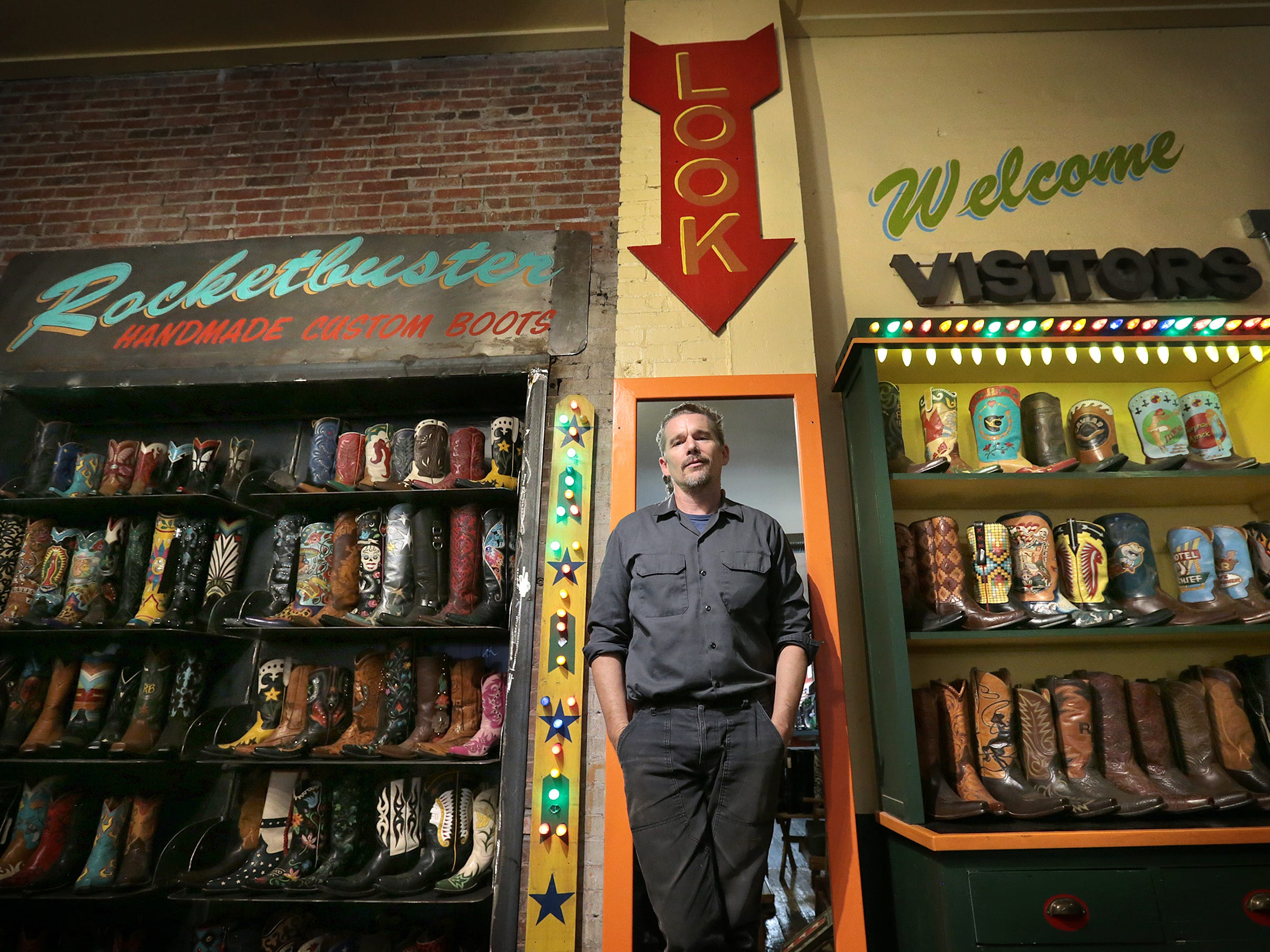 "Ethan Hawke take a break from touring Rocketbuster Boots in downtown El Paso where Ben Dickey, the star of his newest film ""Blaze,"" was fitted for a pair of boots."
