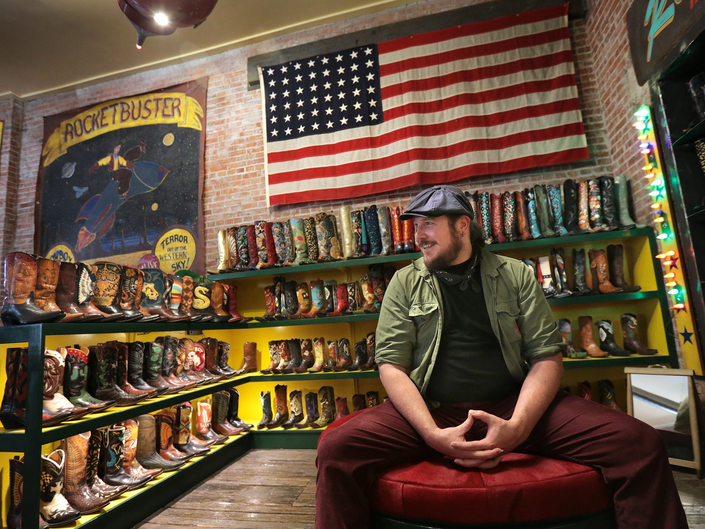 "Ben Dickey who plays Blaze Foley in Ethan Hawke's new film ""Blaze"" waits to be fitted for a pair of custom Rocketbuster Boots Tuesday in downtown El Paso."
