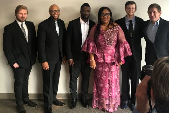Anthony Angelini is on the far left. Ebenezer Norman is third from left and next to him is Leymah Gbowee.