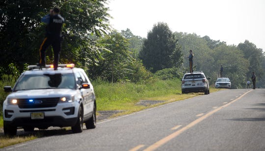 Police search for a suspect off Hance Bridge Road in East Vineland on Tuesday, August 28.