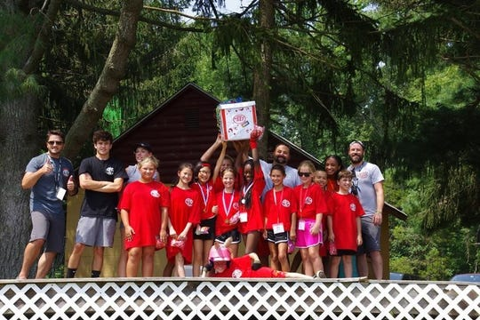 Red Bulls celebrate their color wars victory during the Southwest Council's Camp YEY (Youth Empowering Youth) at Camp Edge in Alloway.
