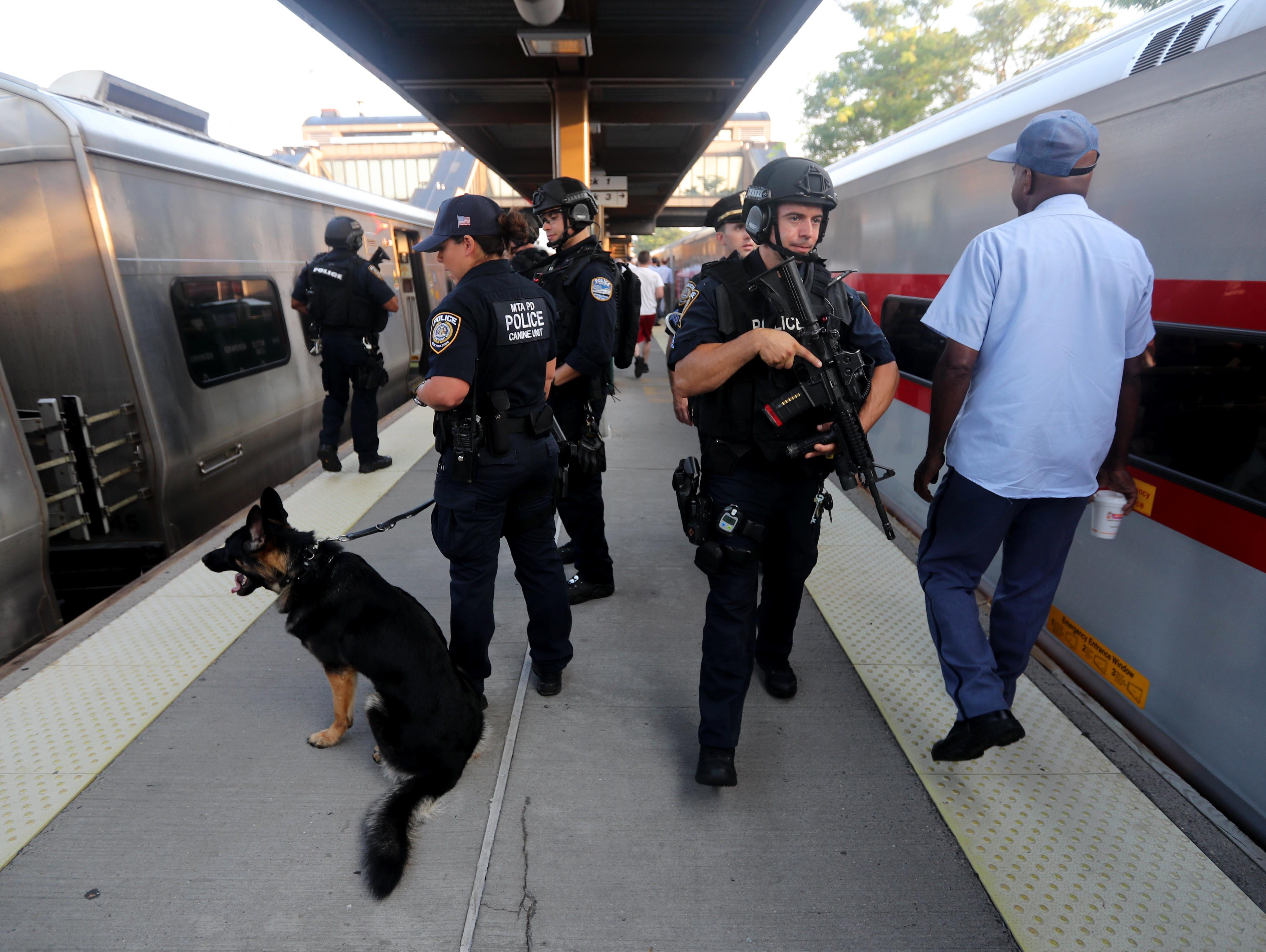 Police officers stand on the platform at the Croton-Harmon station during a multi-department safety drill Aug. 28, 2018. Officers from the MTA, Amtrak, Croton Harmon, New York State Police, TSA, and Department of Homeland Security departments took part in the drill during the morning rush hour. The drill involved heightened platform patrols, increased security presence onboard trains, explosives detection canine sweeps, and counter-surveillance measures. Similar drills were also held at several other Hudson Line stations during the morning commute.