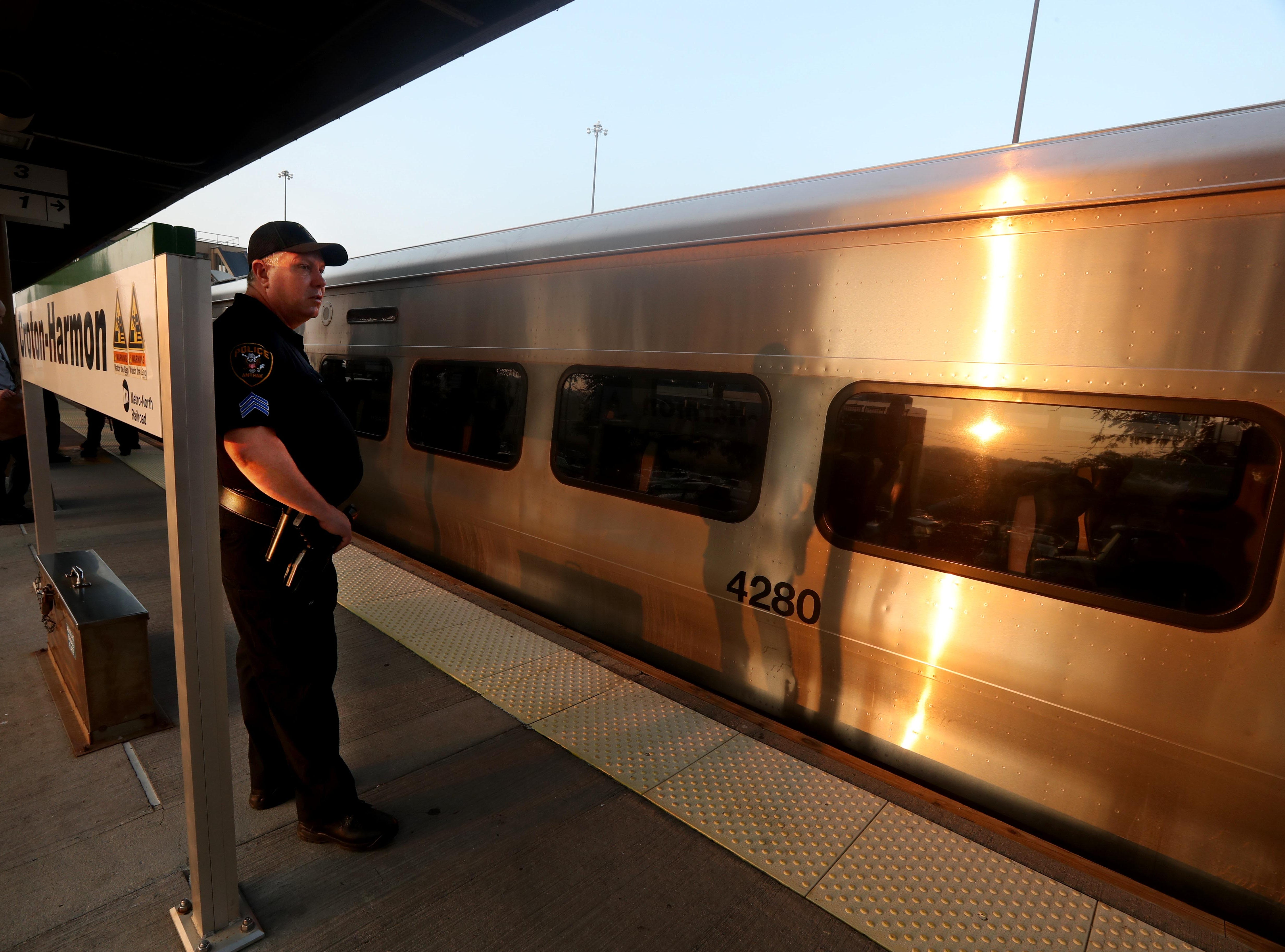 An Amtrak police officer stands on the platform at the Croton-Harmon station during a multi-department safety drill Aug. 28, 2018. Officers from the MTA, Amtrak, Croton Harmon, New York State Police, TSA, and Department of Homeland Security departments took part in the drill during the morning rush hour. The drill involved heightened platform patrols, increased security presence onboard trains, explosives detection canine sweeps, and counter-surveillance measures. Similar drills were also held at several other Hudson Line stations during the morning commute.