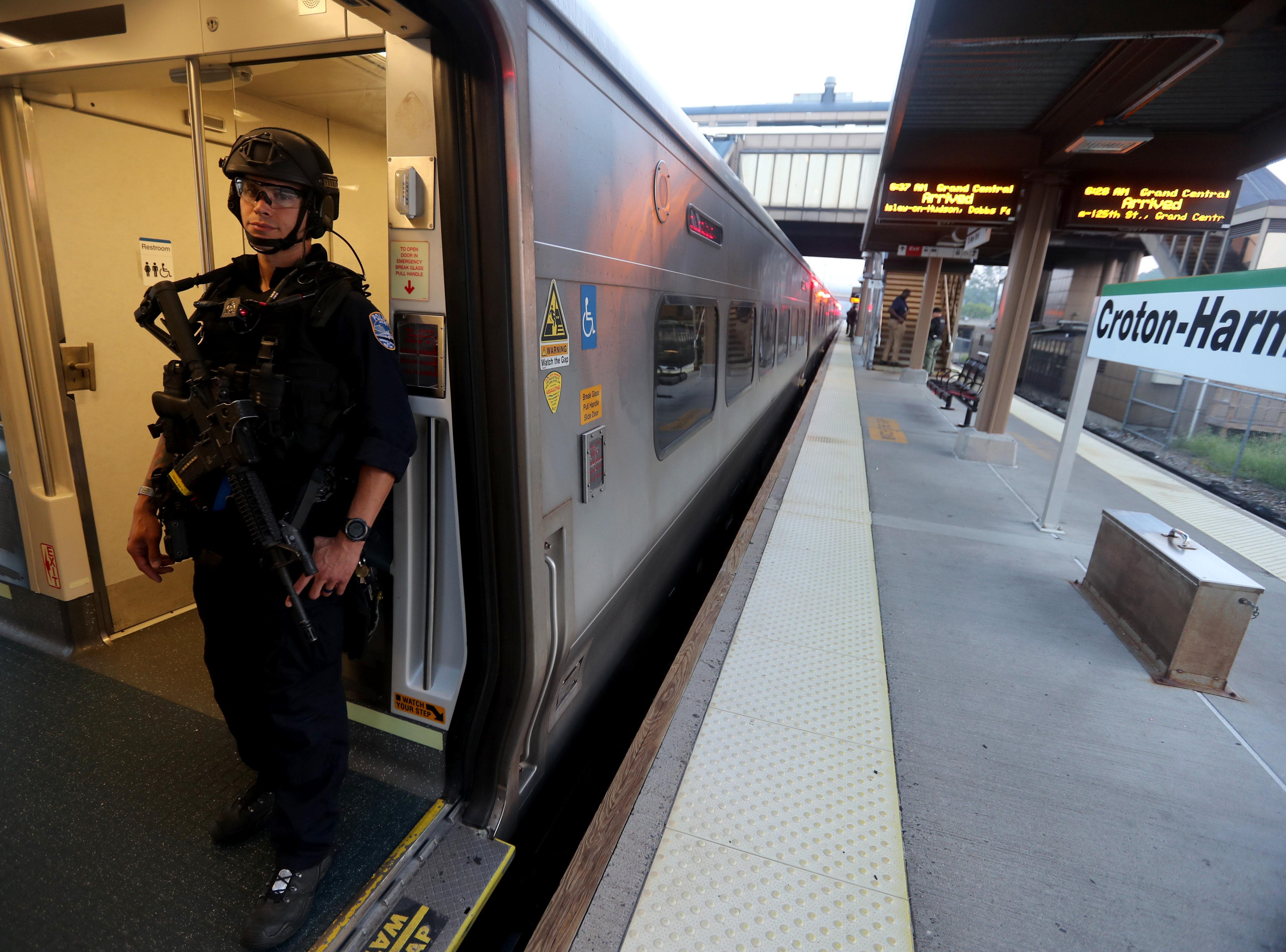 MTA police officer Adrian Torres stands on a New York City bound Metro-North train at the Croton-Harmon station during a multi-department safety drill Aug. 28, 2018. Officers from the MTA, Amtrak, Croton Harmon, New York State Police, TSA, and Department of Homeland Security departments took part in the drill during the morning rush hour. The drill involved heightened platform patrols, increased security presence onboard trains, explosives detection canine sweeps, and counter-surveillance measures. Similar drills were also held at several other Hudson Line stations during the morning commute.