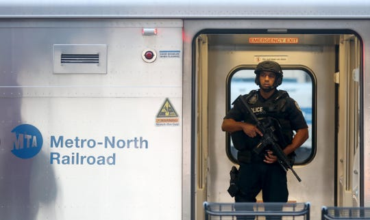 An MTA police officer stands inside a New York City bound Metro-North train at the Croton-Harmon station during a multi-department safety drill Aug. 28, 2018. Officers from the MTA, Amtrak, Croton Harmon, New York State Police, TSA, and Department of Homeland Security departments took part in the drill during the morning rush hour. The drill involved heightened platform patrols, increased security presence onboard trains, explosives detection canine sweeps, and counter-surveillance measures. Similar drill were also held at several other Hudson Line stations during the morning commute.