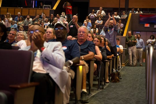 The crowd reacts to an answer during a U.S. Senate debate between Sen. Tom Carper and Democratic primary candidate Kerri Evelyn Harris Monday night at Cab Calloway School of the Arts.