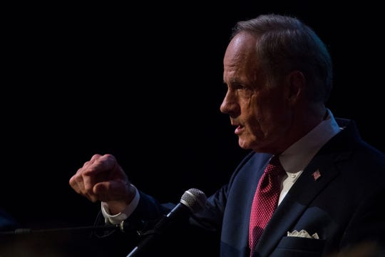 Sen. Tom Carper answers questions during a debate with Democratic primary candidate Kerri Evelyn Harris Monday night at Cab Calloway School of the Arts.