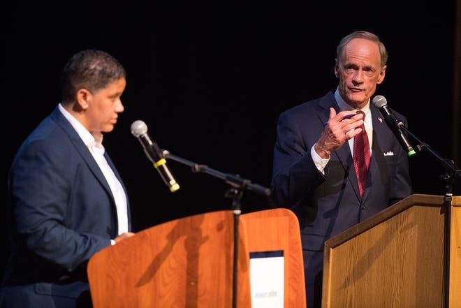 Sen. Tom Carper and Democratic primary candidate Kerri Evelyn Harris debate Monday evening at Cab Calloway School of the Arts.