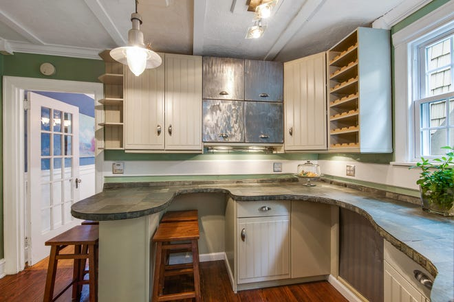 The breakfast nook at 319 Woodside Ave. features seating, cabinetry and wine storage.