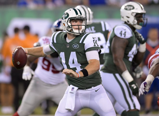 New York Jets quarterback Sam Darnold (14) steps back to throw against the New York Giants during the second quarter of an NFL football game, Friday, Aug. 24, 2018, in East Rutherford, N.J. (AP Photo/Bill Kostroun)