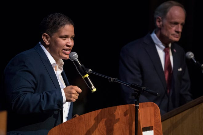 Democratic primary candidate Kerri Evelyn Harris, left, answers questions during a debate with Sen. Tom Carper Monday night at Cab Calloway School of the Arts.