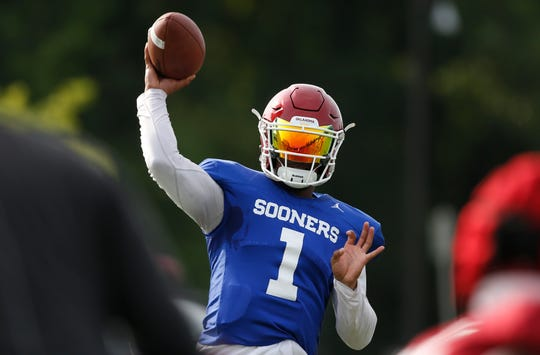 Oklahoma quarterback Kyler Murray throws during an NCAA college football practice in Norman, Okla., Thursday, Aug. 16, 2018. (AP Photo/Sue Ogrocki)