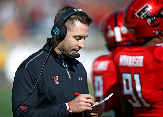 FILE - In this Nov. 18, 2017, file photo, Texas Tech coach Kliff Kingsbury looks down at his notes during the second half of the team's NCAA college football game TCU in Lubbock, Texas. With David Gibbs going into his fourth season as defensive coordinator, and the defense greatly improved in that time, Kingsbury can put more attention into the quarterback situation. The defense could also take some pressure off of the offense. (AP Photo/Brad Tollefson, File)