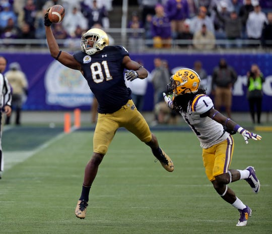 FILE - In this Jan. 1, 2018, file photo, Notre Dame wide receiver Miles Boykin (81) makes a one handed catch in front of LSU defensive back Donte Jackson (1) for a 55-yard game winning touchdown during the second half of the Citrus Bowl NCAA college football game, in Orlando, Fla. With only 15 career catches, one start and 232 receiving yards, Notre Dame wide receiver Miles Boykin was a relatively untapped commodity heading into the final game of his junior season last Jan. 1 against LSU in the CItrus Bowl. Any anonymity was lifted that New Years Day when Boykin enjoyed his coming-out party with three catches and 103 yards, including a one-handed, 55-yard circus catch for a game-winning touchdown that secured him bowl MVP honors and a place in Notre Dame lore. (AP Photo/John Raoux, File)