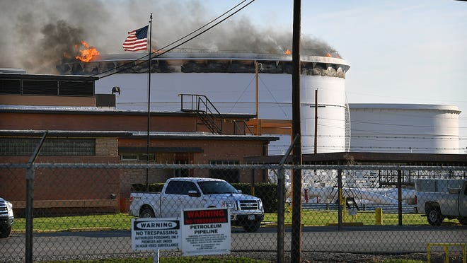 Fire burns in an oil storage tank at Plains All American Pipeline LP on Harding Street Tuesday morning. The fire was reported about 7:40 a.m. and Wichita Falls and Wichita County emergency personnel responded.