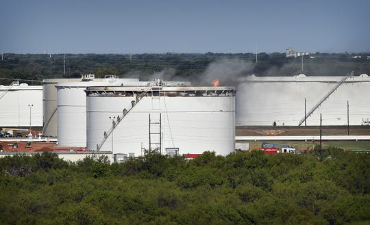 Wichita Falls firefighters work to control an oil tank fire at Plains All American Pipeline LP on Harding Street Tuesday morning. The fire was reported about 7:40 a.m. and dozens of workers were evacuated from the area.