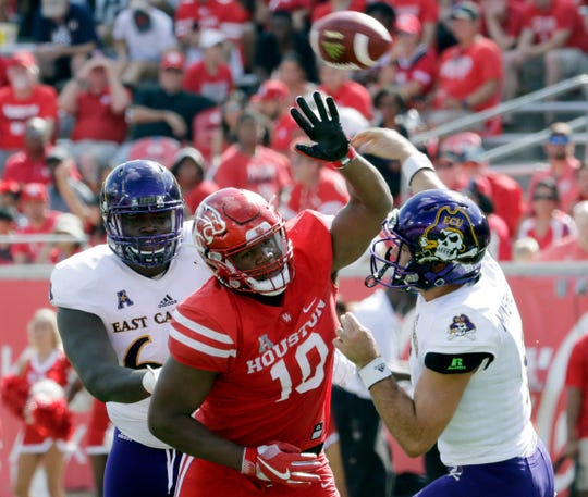 FILE - In this Nov. 4, 2017, file photo, Houston defensive tackle Ed Oliver (10) tries to break up a pass by East Carolina quarterback Gardner Minshew (5) during the first half of an NCAA college football game, in Houston. Oliver was selected to the AP Preseason All-America team, Tuesday, Aug. 21, 2018. (Michael Wyke/Houston Chronicle via AP, File)