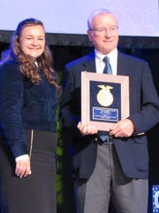 Longtime farm editor Jim Massey received the VIP award from the Wisconsin Organization of FFA at the group's convention earlier this summer for his support of youth and agriculture programs and his service to the FFA Foundation. Pictured with him is last year's FFA State President Ciera Ballmer.