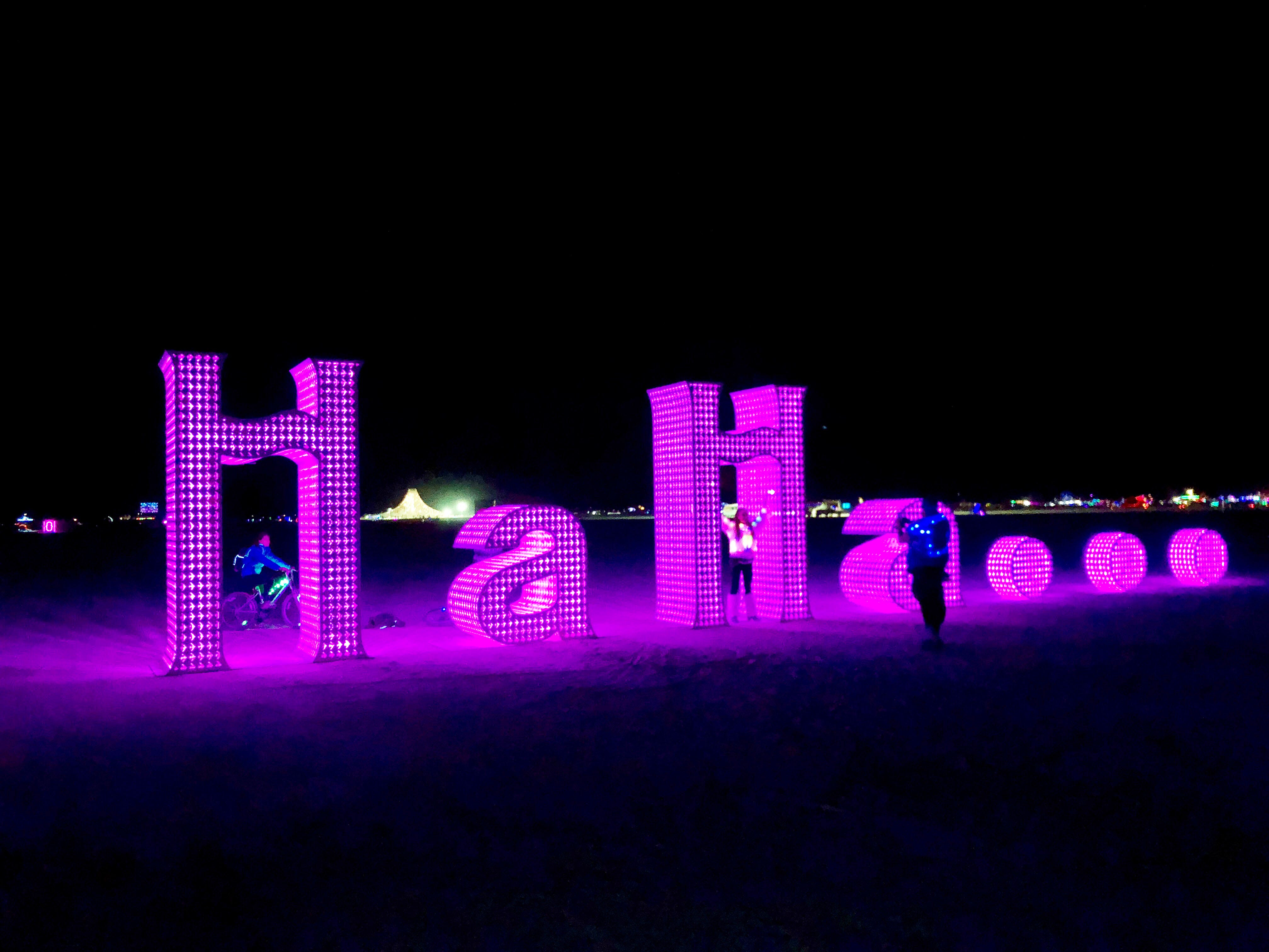 An illuminated art installation at Burning Man echoes a common texting phrase.