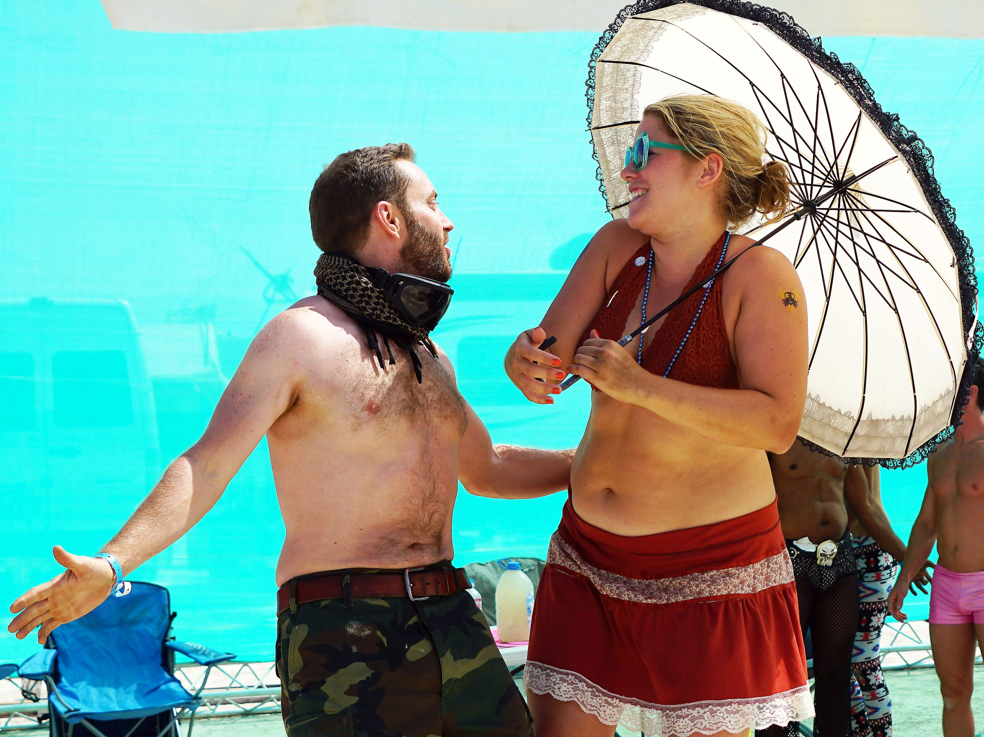 Scott Holden of San Francisco pretends to serenade Hanna Sabelstrom, also of San Francisco, during a party at Burning Man.