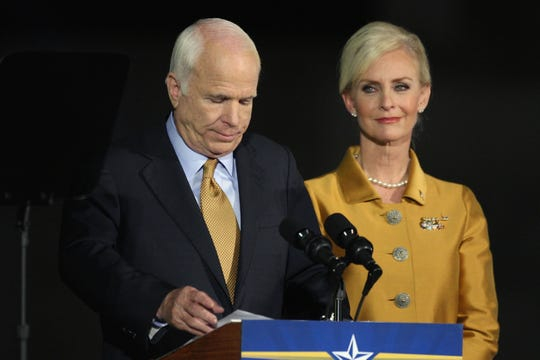 Republican presidential nominee U.S. Sen. John McCain, R-Ariz., concedes victory on stage with his wife, Cindy McCain, during an election night rally at the Arizona Biltmore Resort & Spa on Nov. 4, 2008, in Phoenix.