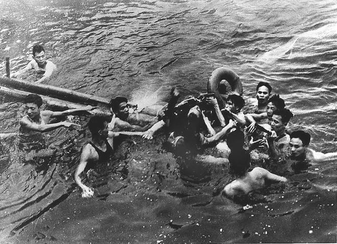Navy fighter pilot John McCain, center, is shown in this Library of Congress picture being captured Oct. 26, 1967, by Vietnamese civilians in Truc Bach Lake near Hanoi, Vietnam.