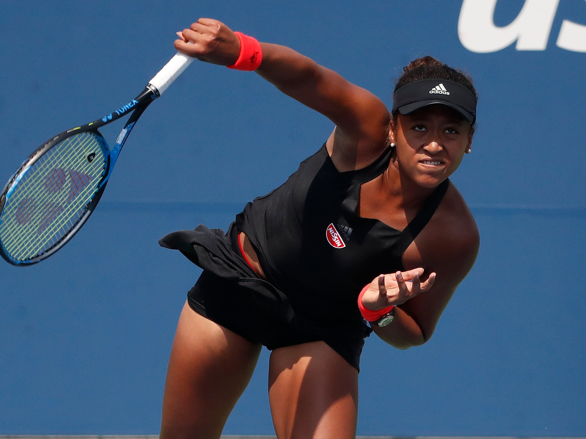 Naomi Osaka of Japan serves against Laura Siegemund of Germany.