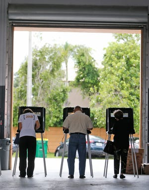 Voters cast their ballots at the Miami-Dade County West Sunset Fire Rescue Station, during the Florida primary election, Aug. 28, 2018, in Miami.