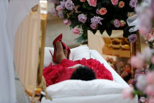 Aretha Franklin lies in her casket at Charles H. Wright Museum of African American History during a public visitation in Detroit, Tuesday, Aug. 28, 2018.