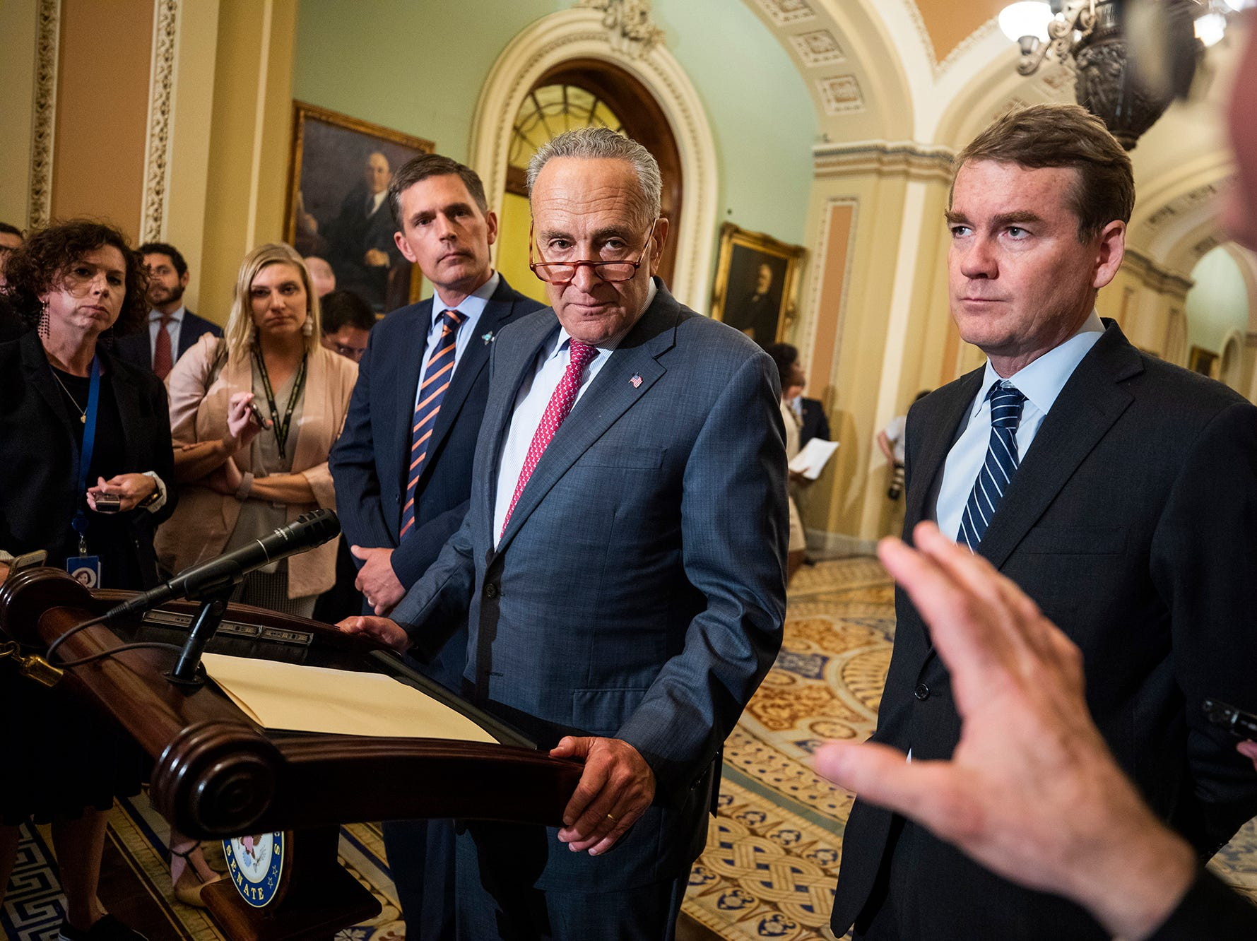 Republican Senate Minority Leader from New York Chuck Schumer, center,  takes questions from the media in the US Capitol in Washington, DC on Aug. 28, 2018. Schumer spoke about renaming the Russell Senate Building after the late Republican Senator from Arizona John McCain.