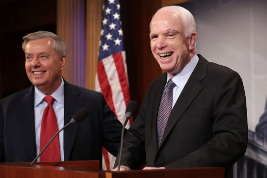 "Sen. John McCain, R-Ariz., and Sen. Lindsey Graham, R-S.C., hold a news conference to say they would not support a ""Skinny Repeal"" of health care at the U.S. Capitol July 27, 2017, in Washington, D.C. The Republican senators were longtime friends."