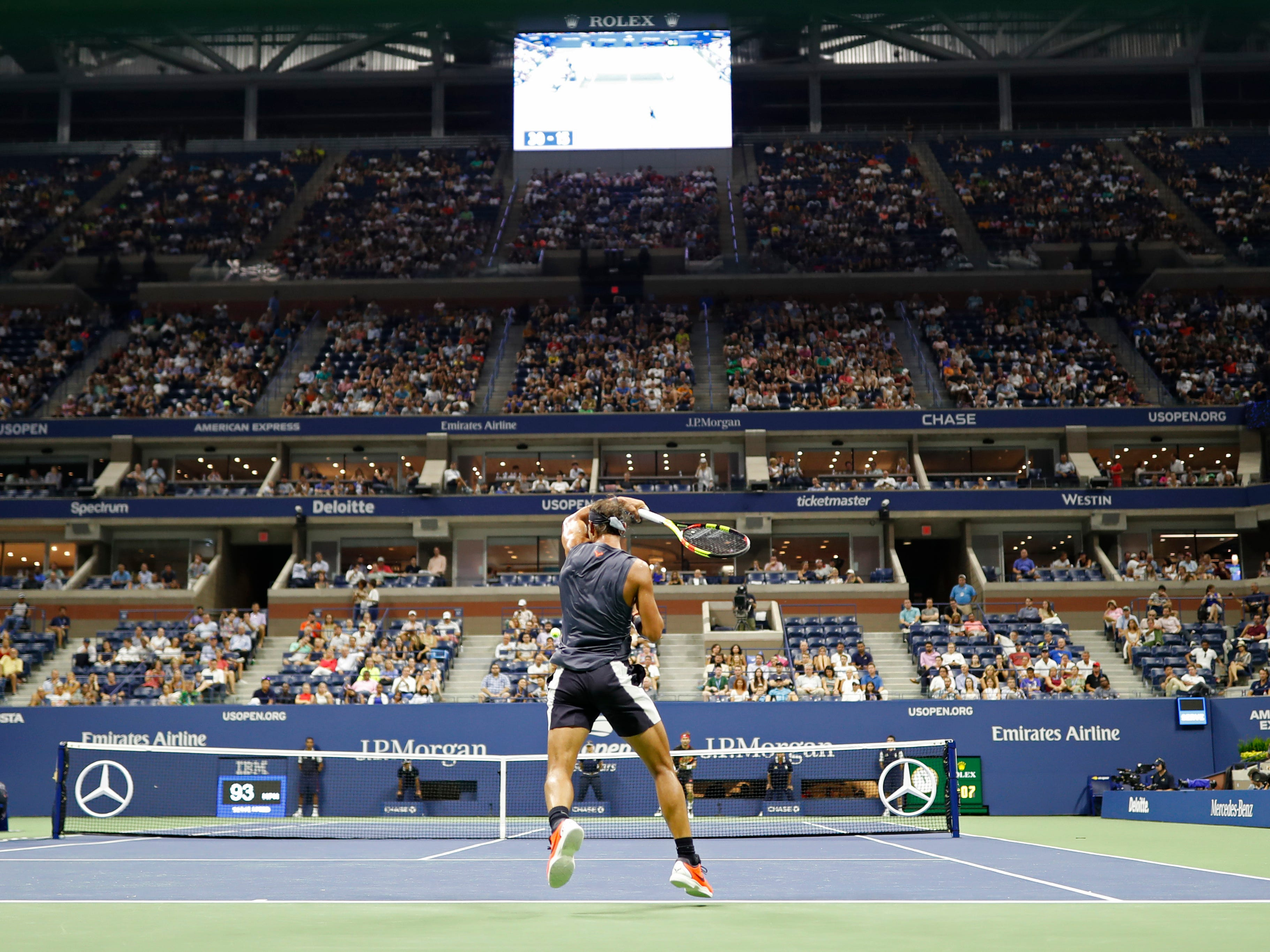 Rafael Nadal of Spain rifles a forehand. Nadal advanced when opponent David Ferrer, playing in his final Grand Slam match, retired with an injury in the second set.