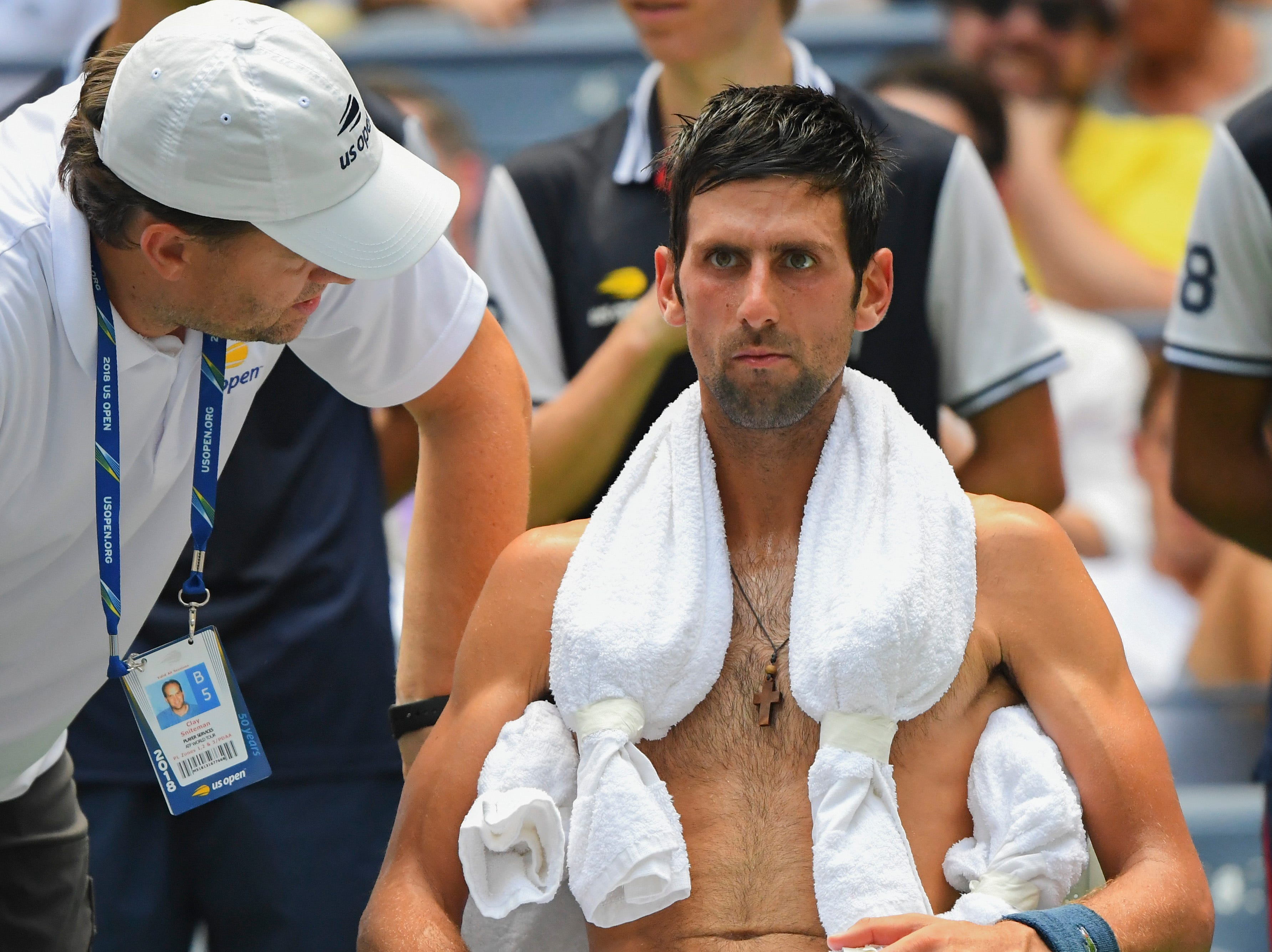 Novak Djokovic copes with the extreme heat while playing Marton Fucsovics.