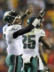 Former Philadelphia Eagles quarterback Michael Vick, shown here in a 2010 game against the Redskins, was an elite fantasy player in his prime. But he also saw the prevalence of the activity behind bars when he served time in federal prison.