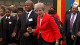 British Prime Minister Theresa May showed off her dance moves as she visited a school in Cape Town, South Africa.