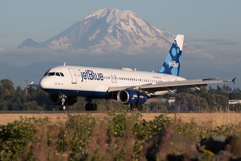 A jetBlue Airbus A320 lands at Seattle-Tacoma International Airport in July 2017.