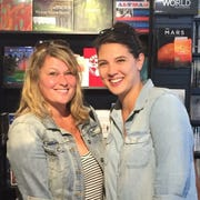 Publicist Crystal Patriarche, left, poses with author Taylor Jenkins Reid at Pages Bookstore in Manhattan Beach, California, during a publicity tour.