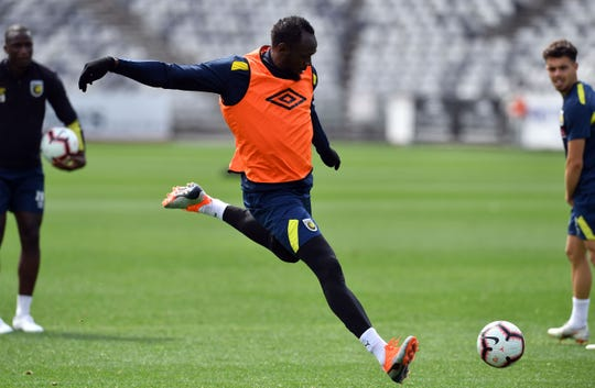 Eight-time Olympic champion Usain Bolt trains with A-League football club Central Coast Mariners.