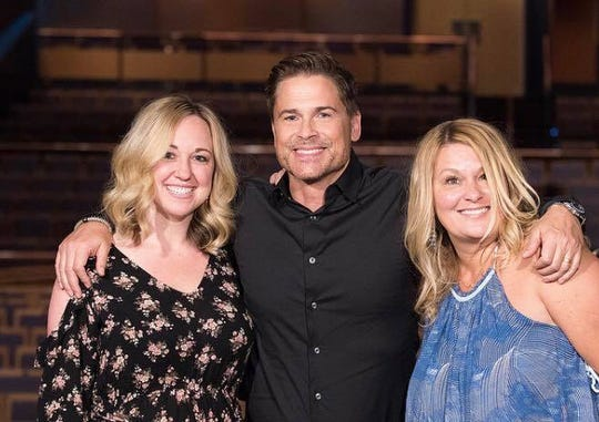 Crystal Patriarche, right, poses for a photo with actor Rob Lowe and her director of marketing, Christelle.