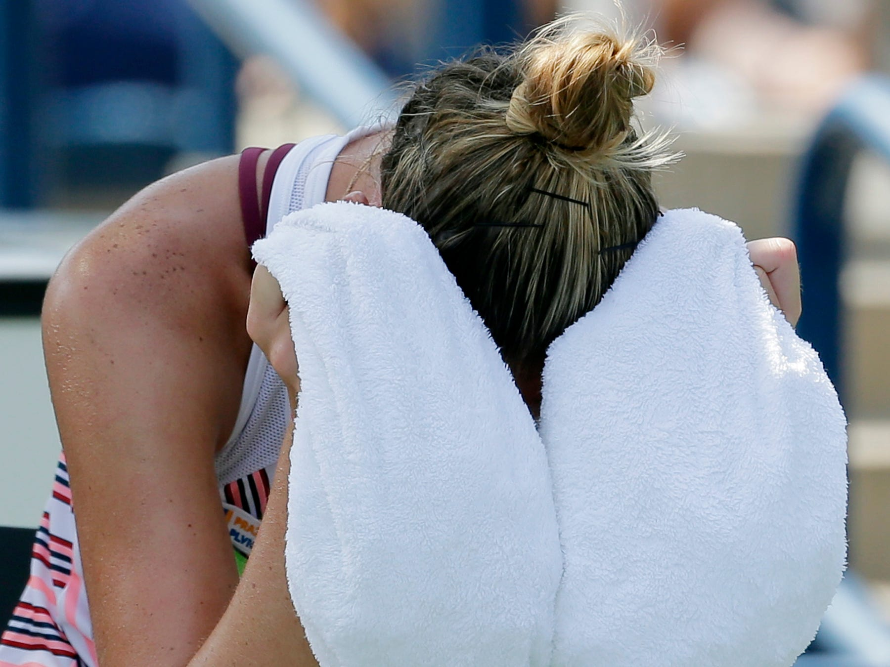 Kristyna Pliskova cools off with an ice towel during a changeover in her match against Kiki Bertens.