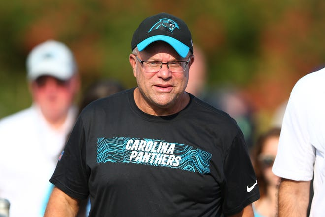 Carolina Panthers owner David Tepper walks to the field during training camp held at Wofford College.