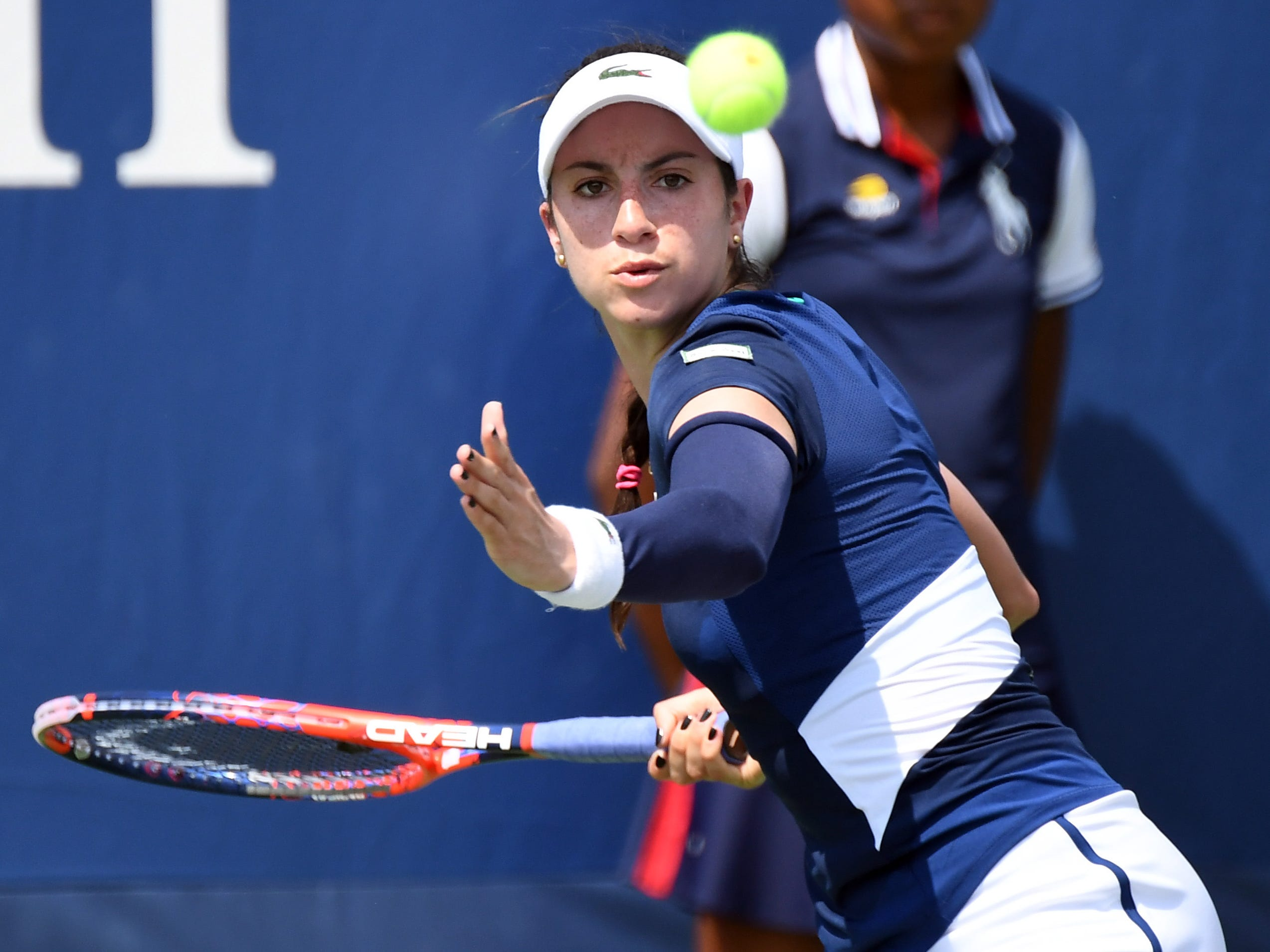 Christina McHale hits to fellow American Francesca Di Lorenzo.