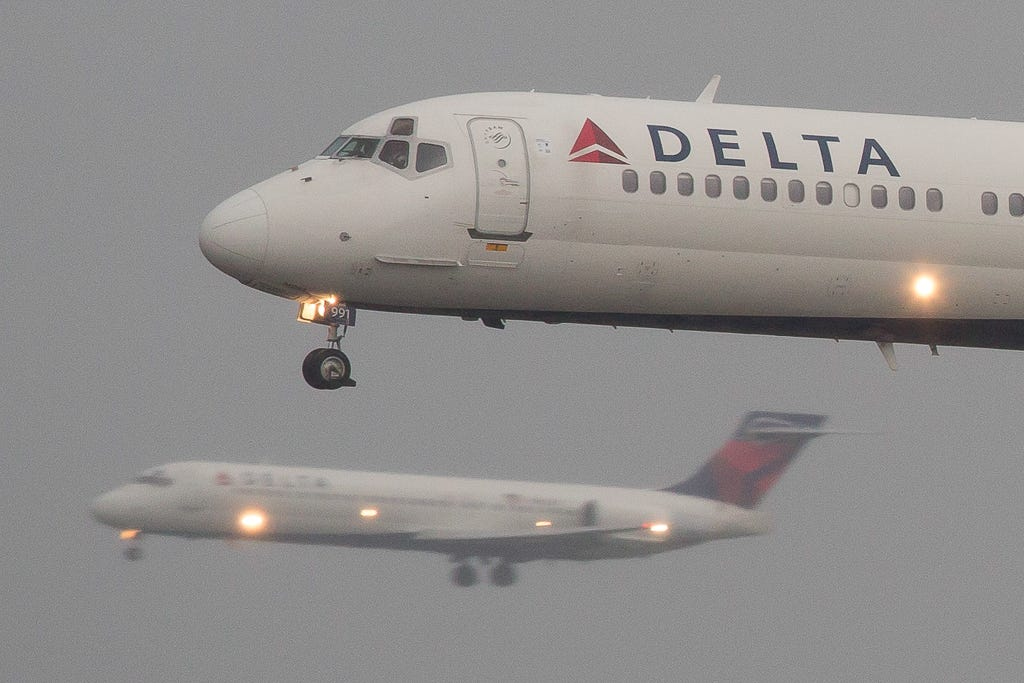 Delta flight aborted, landing gear catches fire at JFK