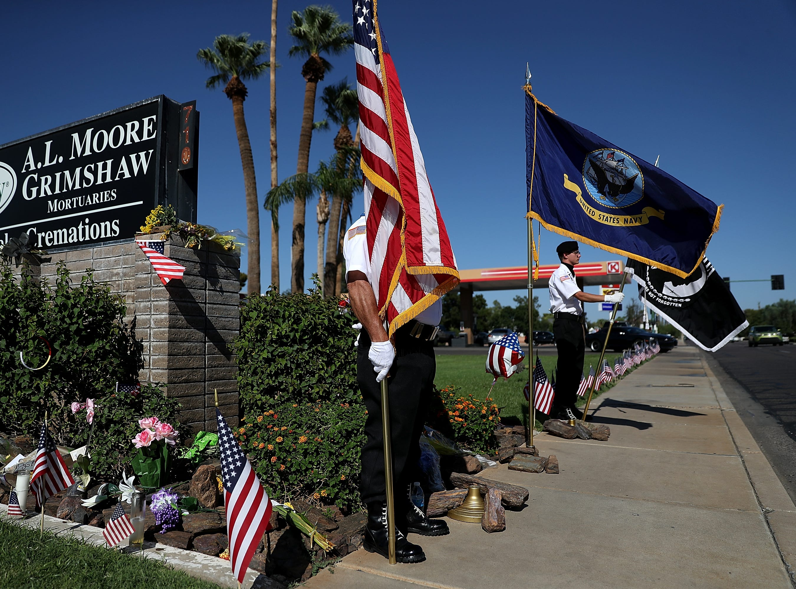 Members of the POW-MIA-KIA Honor Guard stand watch at a makeshift memorial for U.S. Sen. John McCain outside of the A.L. Moore Grimshaw mortuary on Aug. 27, 2018 in Phoenix, Ariz.