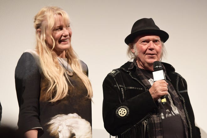 "Earlier this year, Neil Young starred in Netflix's ""Paradox,"" a film written and directed by Daryl Hannah. Rumor is, the two have gone beyond just working together, and have tied the knot."