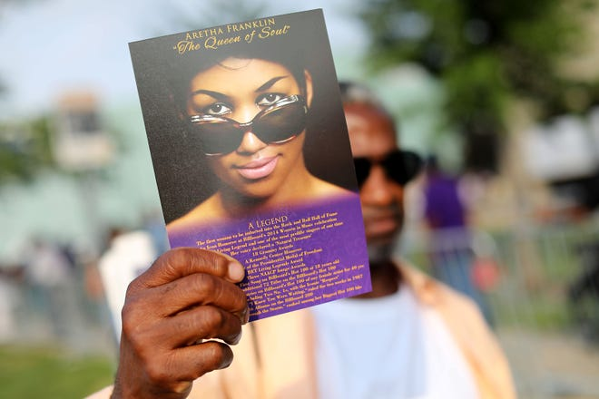 Aug. 28, 2018; Detroit, MI, USA; Charles Thomas, 56, of Detroit holds a tribute card he got after viewing Aretha Franklin as she lays in state at the Charles H. Wright museum in Detroit on Tuesday, Aug. 28, 2018. Franklin will lay in state for 2 days. Mandatory Credit: Kimberly P. Mitchell/Detroit Free Press via USA TODAY NETWORK ORIG FILE ID:  20180828_ajw_usa_347.jpg