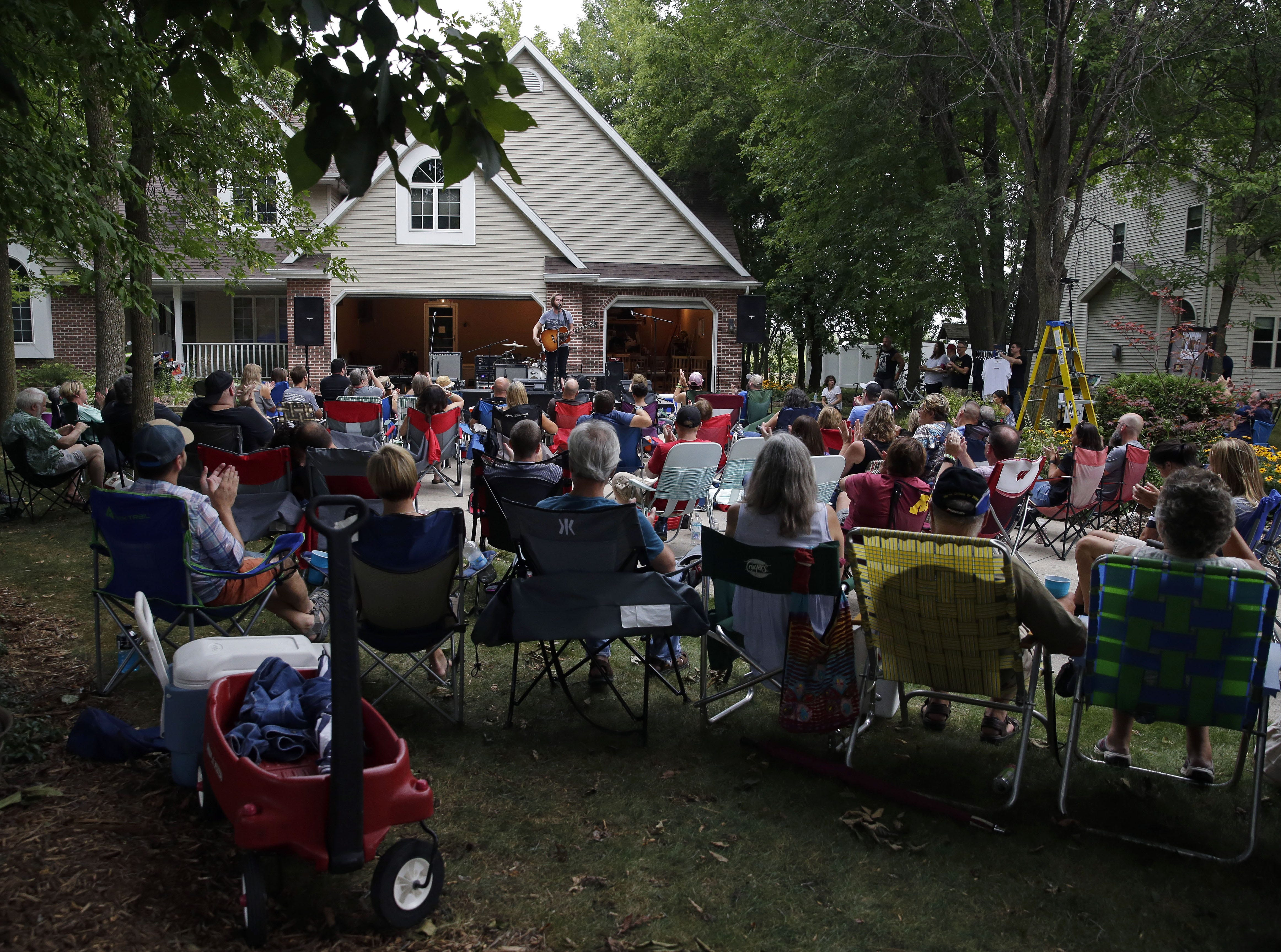 Nashville artist Carter Hulsey plays to a crowd of about 150 people at the Appleton home of Todd Van Hammond in late August. Van Hammond has been inviting bands to play inside and outside his house for about a decade.