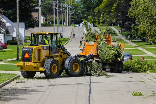 Waupun's Department of Public Works crews clean outlets from streets Wednesday, August 29, 2018, in Waupun, Wisconsin. Heavy weather hit the Waupun area, causing major damage on Tuesday afternoons and affecting a potential tornado in some places. Doug Raflik / USA TODAY NETWORK Wisconsin
