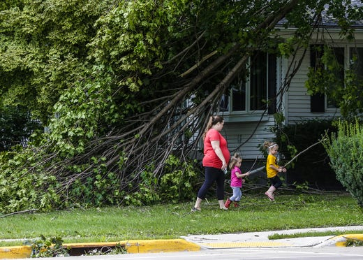 Holly, Lillian and Addalyn McDaniel look over damage to trees at the house Wednesday, August 29, 2018, 201 West Main Street in Waupun, Wisconsin. Heavy weather hit the Waupun area, causing major damage on Tuesday afternoons and affecting a potential tornado in some places. Doug Raflik / USA TODAY NETWORK-WISCONSIN